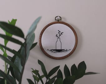tiny vase and plant 5 inch hand stiched embroidery hoop