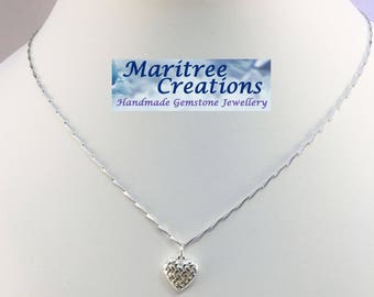 """925 Sterling silver 18"""" necklace with heart pendant."""