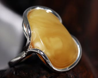 Baltic Amber Ring. Unique milky type of Amber fitted in sterling silver setting. Handmade & unique. Ring is adjustable.