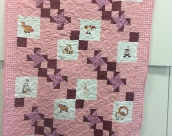 Embroidered baby quilt.