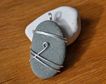 Wire wrapped pebble pendant