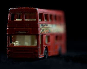 """14"""" x 20"""" archival photograph of a toy double decker bus."""