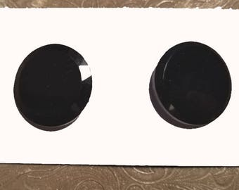 Two vintage jet black glass buttons