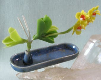 Dollhouse Miniature Long Tray Ikebana in Slate Blue Glaze with Yellow Orchid for One Inch Scale Dolls House