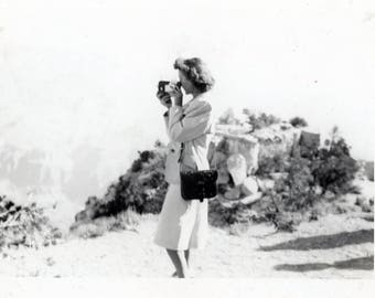 vintage photo 1950s Young Lady Takes Movie off Mountain Top