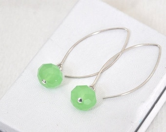 Sterling silver dangling earrings with green crystals