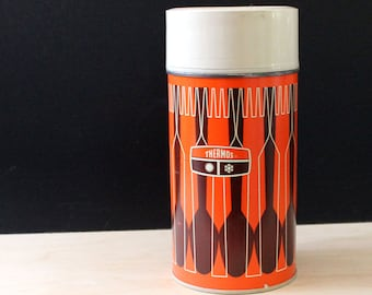 Vintage thermos. Spoons and forks design in orange and red.