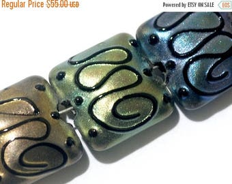 ON SALE 30% off Seven Different Color Pearl Surface Pillow Beads -11204904-Handmade Lampwork Glass