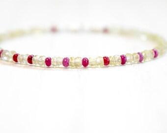 ruby & lemon quartz bracelet.  smokey lemon quartz bracelet with ruby gemstone. yellow and pink delicate beaded bracelet