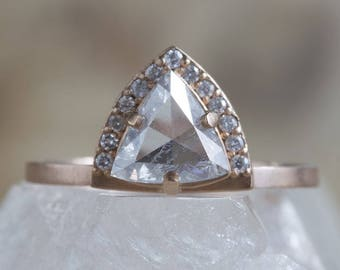 One of a Kind Silver-Blue Trillion Diamond Ring with Half Halo