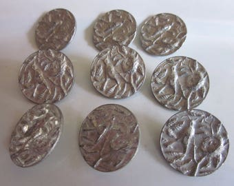 "Set of nine metal bird in nest buttons.  Silver metal 3/4"" wide"