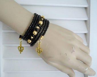 Wrap Bracelet - Black Seed Bead - Gold Metal Beads - New Orleans Saints Fleur de lis Charm - Memory wire - One size fits all - bycat
