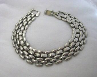 Vintage silver tone link bracelet with fold over clasp