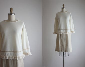 knit fringe blouse