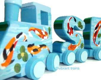 Custom SEVEN LETTER Alphabet Name Train, Hand Made and Hand Painted to Meet Your Design Needs. Complete with Engine and Caboose.