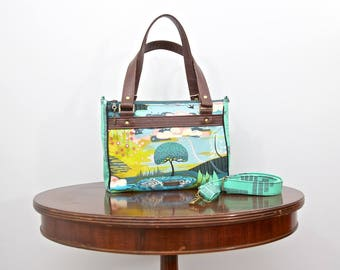 Dandelion Double Zip Handbag in Anna Maria Horner Fibs and Fables with optional cross body strap