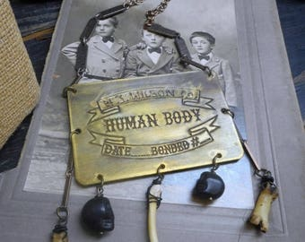 The Strange Case of the Necrophiliac Doctor. Antique coffin tag, Coyote bones & Skulls Gothic Necklace