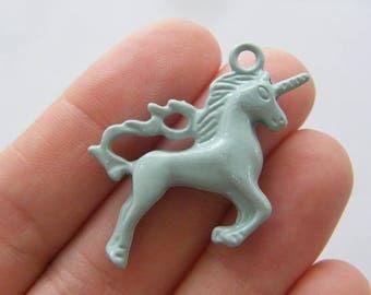 4 Unicorn charms mint green tone A663