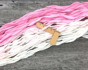 Handspun yarn, rose to cream ombre, 50 yards and 3.15 ounces/ 89 grams, thick and thin in merino wool