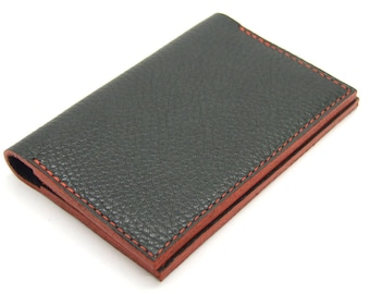 Navy blue leather card holder with red detailing