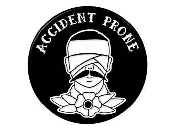 Accident Prone Enamel Pin. Glow In The Dark Wounded Man with Flower Pin.