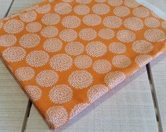 Orange flower burst cotton fabric