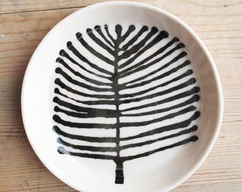 porcelain dish screen printed tree pattern in black.