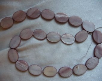 Beads, Shades of Brown Mother of Pearl, 18x14mm oval.  Sold per 16 inch strand.  There are 22 beads on the strand.