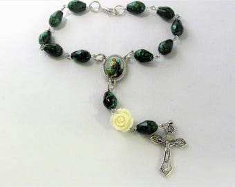 Car Rosary with a White Rose