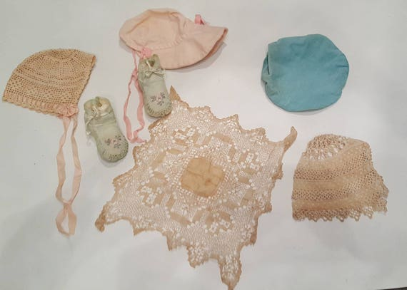 Lot of vintage baby hats, shoes, doily