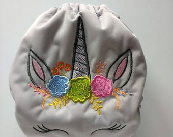 SassyCloth one size pocket diaper with floral unicorn embroidery on light gray PUL. Made to order.