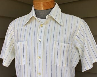 vintage 1970's -Manhattan 'Anytimer'- Men's short sleeve shirt. Polyester knit. White with Blue & Yellow stripes. Large 16 1/2