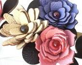3 leather rosettes