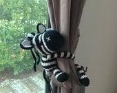2 zebra curtain tie backs (K.Nicha)