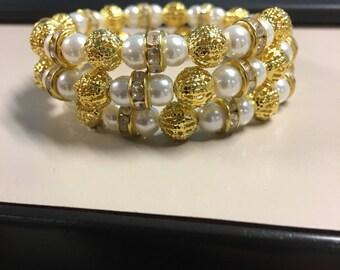 Gold and white beaded bracelet