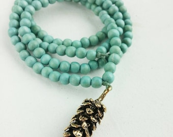 wooden necklace with pinecone pendant...