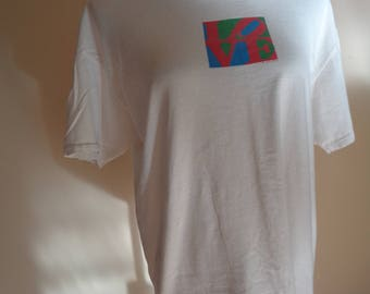 Vintage 1997 Classic White T-Shirt with the iconic word LOVE printed in front from the Limited Label in Vintage Condition, LOVE Conquers All