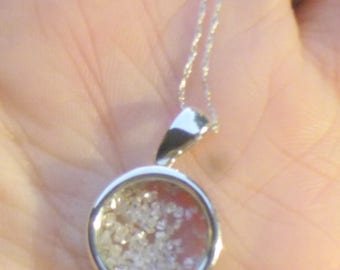Floating diamonds pendent in white gold  50 points total weight  necklace with an 18 inch white gold chain