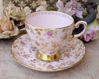 Gorgeous English Bone China Teacup and Saucer with Hand Painted Roses