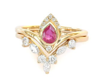 Pear ruby engagement ring atyasha with hermes side ring, diamond wedding rings set, bridal set