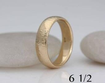 Wedding band, size 6 1/2 and custom sizes, lightly hammered 14k yellow gold, #526.