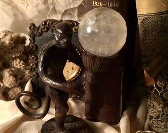 Vintage Bronze Monkey holding a Quartz Crystal Ball