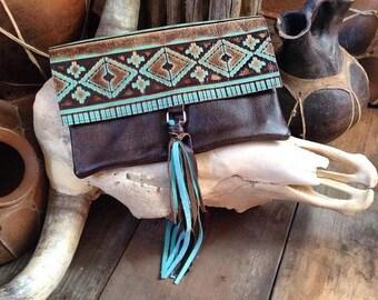 ON SALE Aztec print embossed leather tassel clutch