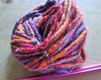 hand spun art yarn, core spun and felted . Sunset colours