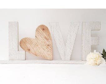 LOVE writing + natural or colored or heart-shaped recovery wood base