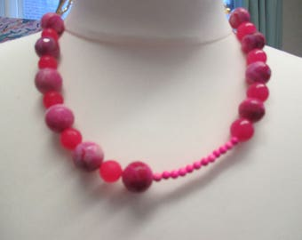 A pink quartz necklace with gold plated chain and clasp