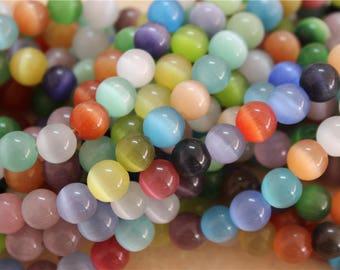 48 pearls 8mm cat's eye glass