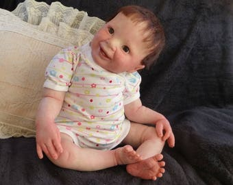 Reborn big baby Samantha. Gorgeous baby with two little bottom teeth! Kit is Samantha by Donna RuBert. Comes with quailty layette. Realistic