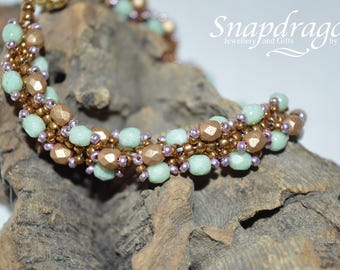 Mint green and bronze spiral beaded rope bracelet with a magnetic clasp