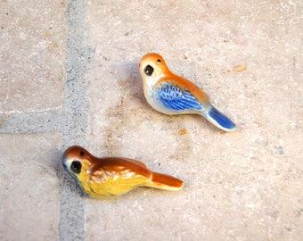 Two small ceramic birds